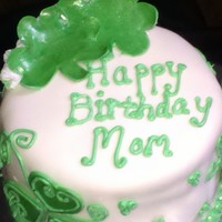 Shamrock Cake Chocolate Cake w/ cookies and cream filling wrapped in MMF