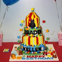Circus Cake A circus/carnival themed cake. Circus tent is made from cereal treats. Figures and decorations are made from MMF. Tier borders are gumballs...