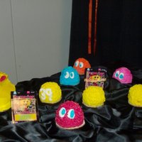 "Ms Pac Man Cake My 15 yr old made this birthday cake for my 80""s themed party. She used the ball pan for ms pac man and the mini doll molds for the..."