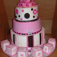 Baby Londyn 3 round tiers butter cream w fondant accents....blocks covered in fondant...