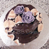 Lil Choc Cake Just a simple chocolate and coffee fudge cake with fondant leaves and sugar paste flowers, a few will silver balls too!