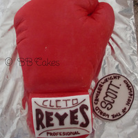 Boxing Glove My first carved cake, red boxing glove, marble cake in the middle and fondant to cover. The details are just done with royal icing.