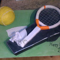 Tennis Bag, Racket And Ball Carved tennis bag out of chocolate mud cake, covered in chocolate ganche, tennis racket made from rice krispie treats, tennis ball made...