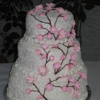 Cherry Blossom Wedding Cake This was my first wedding cake made for a friend. Yellow cake with buttercream and gumpaste flowers.