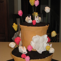 Flower Pot Easter Cake Pound cake with buttercream covered in Fondant with crushed cookies for soil. Flowers are Fondant. Bunnies are gumpaste. Thanks for looking...