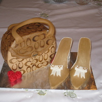 Coach Purse Cake With Shoes Pound cake with MMF and gumpaste shoes. Thank you to Rosie2 for all of her help!!