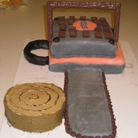 Chainsaw Cake Pound cake with fondant. Sugar cookie blade with chocolate chips for the chain.
