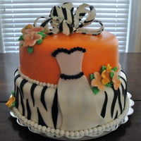 Zebra Stripe & Orange Cake covered with fondant, fondant zebra stripes on bottom layer, fondant and buttercream formal gown, gumpaste flowers and topped with...