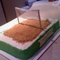 Sand Volleyball Buttercream covered cake. Sand is crumbled graham crackers.