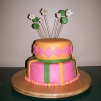 Whimsical Cake Covered in fondant. Sticks are actually spaghetti.
