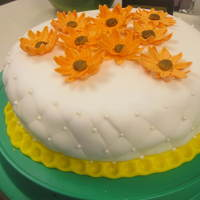 "Fondant Class Final Cake Chocolate cake covered in wilton fondant with stitching technique on the side and pearl dragees. On top are gumpaste ""sunflowers&quot..."