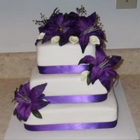 Lily Wedding Cake   3 tier square wedding cake with purple lilies and white calla lilies