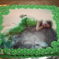 Mermaid Cake Made this cake for a friend. She had her daughters pictures made, and so we used the image on the cake. We also made matching cupcakes. Her...