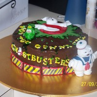 Ghostbusters Cake this is a 9inch round strawberrycake covered in choc ganche ghostbusters theme for my daughters 6th bday all handmade fondant models and...