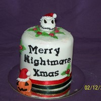 Nightmare Before Christmas  4 inch fruit cake covered in RTR (fondant) decorated with Fondent/gumpaste figures jack skellingon head and pumpkins and holly thx for...