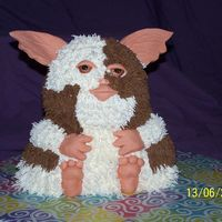 Gizmo Cake  this is a teddy bear cake tin cake with fondant ears ,nose,eyes,hands and feet all buter cream for my mates daughters bday she luvs gizmo...
