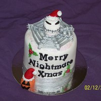 Nightmare Before Christmas 4 inch fruitcake covered in RTR ( fondant) and decorated with Fondont/gumpaste figures jack skellington and pumpkins and royal icing spider...