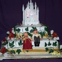 Medieval Wedding Cake  this was for my sister with her medieval themed wedding the top castle is bought and at sisters request , the first tier is choc/caramel...