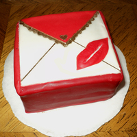 Love Letter   Vanilla bean cake, Raspberry-Hennessy Cream filling, covered in chocolate ganache and fondant