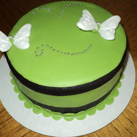 Simply Green Chocolate Cake with cream filling. Fondant decorated, butterflies made of sugar