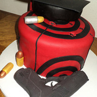 Criminal Justice Grad  Vanilla cake with Swiss Buttercream filling, covered with dark chocolate ganache and fondant. All decorations 100% edible. Took a Beretta...
