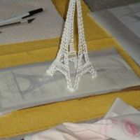 Eiffel Tower Royal Icing Made with tips 2 & 3. Broke before I could attach the 4th side! Oh well, it was fun to make...