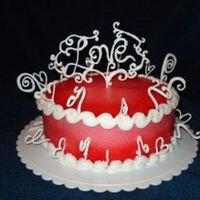 Love Cake Buttercream with red/ pink gradient, royal icing border and decorations.