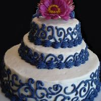 Periwinkle Swirl Cake Periwinkle & white buttercream b-day cake for a good friend. Organic zinnias from my garden on top.