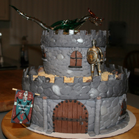 Medieval Castle Our first cake! I had the great pleasure creating our first cake with my daughter for my son's 18th birthday. A pewter knight...