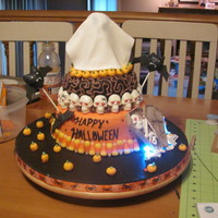 Halloween With Strobe And Blinking Lights. My first two tier cake. I had two blicking lights behind the coffen and a strobe light under the ghoust that showed through the gumpaste....