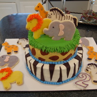 Jungle Animal Cake   My first 2-tiered cake...Jungle/Zoo Animals with Decorated Sugar cookies on top :)