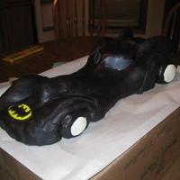 Batmobile Rice krispie covered in white chocolate and marshmallow fondant
