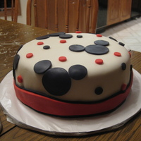 Mickey Mouse Cake Vanilla cake covered with marshmallow fondant and Mickey Mouse made of rice krispies covered with white chocolate and marshmallow fondant