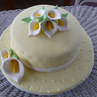 Cala Lilies First fondant cake and first time making cala lilies. thanks for looking