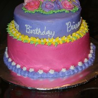 "Birthday Party I made this cake for a friends daughter. This is vanilla cake with buttercream icing. The bottom is 2 10"" and the top is 1 8""..."