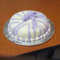 Bosses Day Cake This was my first time using fondant and doing the zebra print. The top was supposed to be a bow but it kept falling.