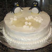 "Penguin Birthday Cake Penguin themed birthday cake. Penguins are hand made out of fondant. The ""ice"" is hardended/melted sugar & water and the &..."