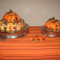 Fall Pumpkins  These were fun to make and a big hit! All edible MMF leaves. The pumpkins are layered cakes, the tops trimmed/rounded. Covered with...
