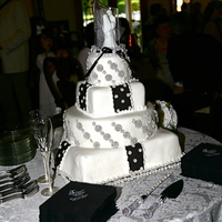 Black And White Square And Round  This was a special request to have the bride and groom favorite candy (Snocaps) included in the cake. The bride was very helpful in...