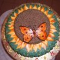 Butterfly Over Sunflower Cake Sunflower Cake, over it a butterfly made in gumpaste. The details, like the petals are made in gumpaste to.
