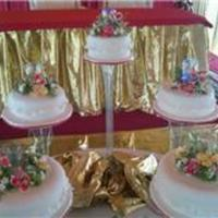 Indian Themed Wedding   five tiers on separate stands in red yellow and gold