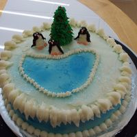 Penguins At The Pond For Christmas  This is a carrot cake decorated with cream cheese icing that I did for my family's Christmas party.The tree is the top of an ice cream...