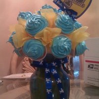 Peidmont Cheer Squad Cupcake Bouquet smore cupcakes, so i used cups, normally i just use toothpicks, glued the cups to the ball, and then double lined the cupcakes and stuck...