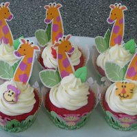 Jungle Themed Cupcakes These cupcake went along with the Diego cake. They are red velvet cupcakes with cream cheese frosting. All accents were from Wilton's...