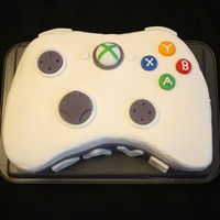 Xbox 360 Controller Cake I made this for my husband's birthday and he loved it! Only problem was I switched my white cake recipe with a new one and the cake...
