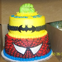 Super Hero Cake This was a spiderman, batman, incredible hulk cake. The bottom tiers are covered with buttercream, and used fondant accents. The hand is...