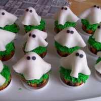 Ghostly Cupcakes Cupcakes that were made for a Halloween Barn Party. Thanks to all the Cakescentral users for their wonderful ideas! these turned out...