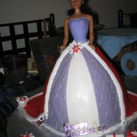 The Graduation Cake This was my first doll cake. I thought it came out pretty good. It was a chocolate cake with chocolate BC and wilton fondant. The doll is a...