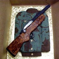 Sons Birthday Cake   My 4th cake but first try with RKT making the gun.