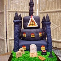 Halloween Castle  Halloween Castle made for grandsons class party. Pound cake with vanilla filling. RKT for towers. Cotton candy not workable to shape webs...